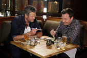 Musician Blake Shelton and host Jimmy Fallon eat sushi during the 'Jimmy Makes Blake Try Sushi' bit on May 24 2016
