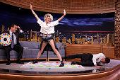 Announcer Steve Higgins actress Kristen Stewart and host Jimmy Fallon play 'Jello Shot Twister' on July 11 2016