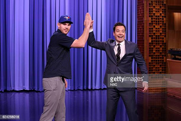 Toronto Blue Jays player Joe Biagini and host Jimmy Fallon highfive during the monologue on November 18 2016
