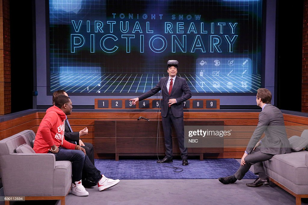 Comedian Michael Che, announcer Steve Higgins, host Jimmy Fallon, and actor Andrew Rannells play 'VR Pictionary' on December 16, 2016 --