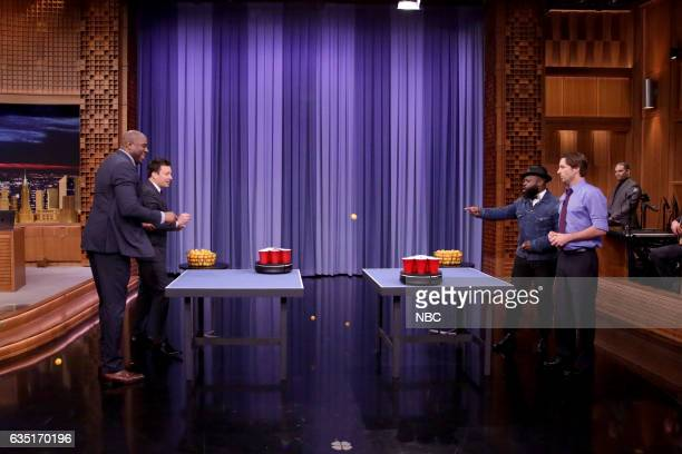 Former professional basketball player Magic Johnson host Jimmy Fallon Tariq Black Thought Trotter of The Roots and actor Luke Wilson play roomba pong...
