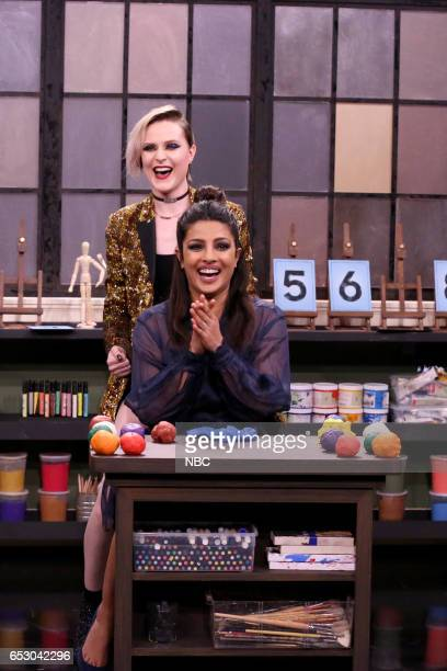 Musical guest Evan Rachel Wood and actress Priyanka Chopra play tandem sculptionary on March 13 2017