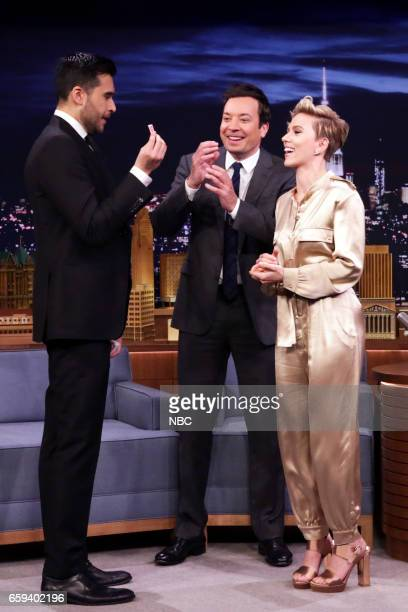 Magician Dan White host Jimmy Fallon and actress Scarlett Johansson during a magic trick on March 27 2017