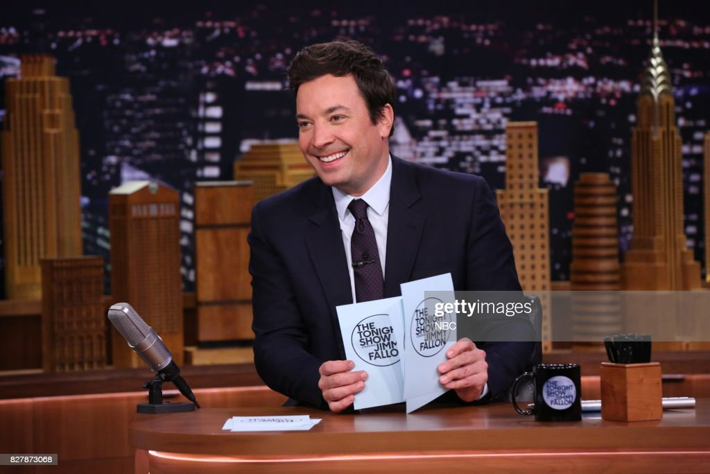 Host Jimmy Fallon arrives at his desk on August 8, 2017 --