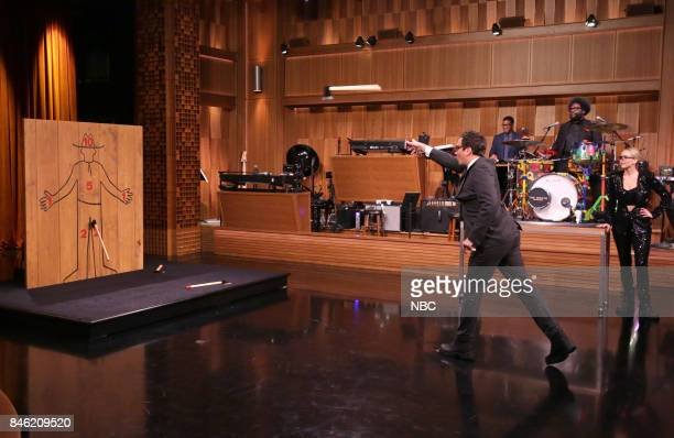 Host Jimmy Fallon 'Axe Throwing' with actress Jennifer Lawrence on September 12 2017