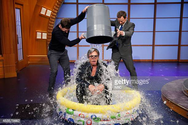 Syd Butler and host Seth Meyer dump a bucket of ice on actor Mickey Rourke for the 'Ice Bucket Challenge' on August 123 2014