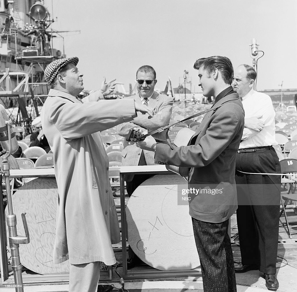 SHOW Episode 10 aired Pictured Host Milton Berle unknown musician Elvis Presley Presley's manager Colonel Tom Parker on the deck of the USS Hancock...