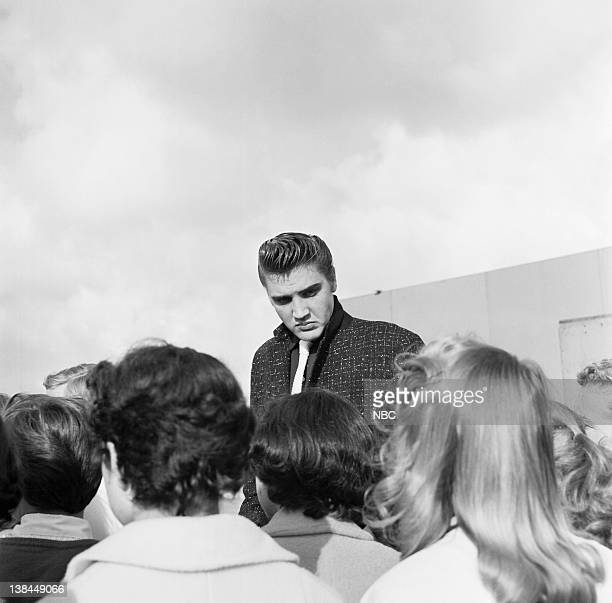SHOW Episode 10 aired Pictured Musician Elvis Presley and fans on the deck of the USS Hancock aircraft carrier