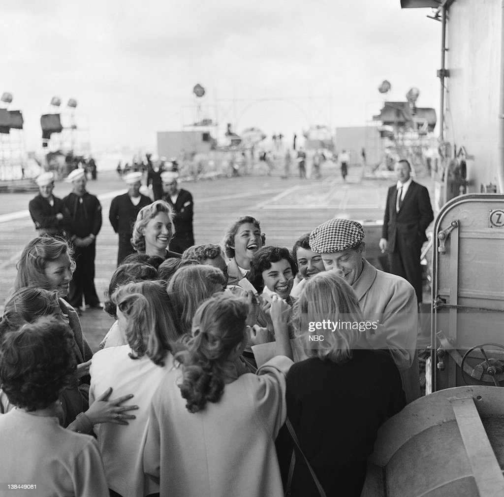 Host Milton Berle with fans on the deck of the USS Hancock aircraft carrier