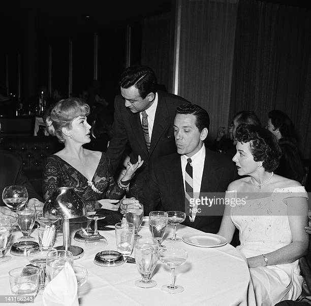 Actress Zsa Zsa Gabor reporter Vernon Scott actor John Conte wife Ruth Conte filmed at the Beverly Hilton Hotel on January 14 1957 Photo by Paul...