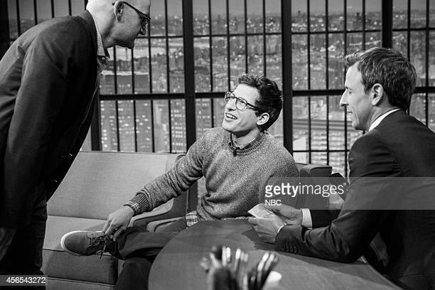 MEYERS Episode 103 Pictured Segment producer Kevin Miller talks with actor Andy Sambert and host Seth Meyers during a commerical break on September...