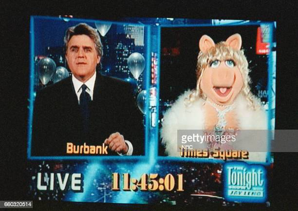 Host Jay Leno talks to Miss Piggy on location in Times Square on December 31 1996 Photo by Margaret Norton/NBC/NBCU Photo Bank via Getty Images