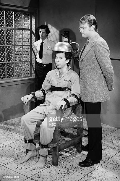 Mitchell Laurance as guard Tom Schiller as Dean Slydell Dan Aykroyd as Roy Groomis during the 'TV Execution' skit on January 15 1977