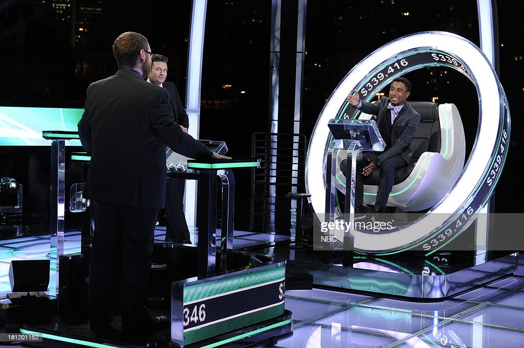 Contestant Andrew Kravis, host <a gi-track='captionPersonalityLinkClicked' href=/galleries/search?phrase=Ryan+Seacrest&family=editorial&specificpeople=201694 ng-click='$event.stopPropagation()'>Ryan Seacrest</a>, contestant Brandon Saunders --