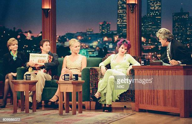 Actress Florence Henderson actor Noah Wyle actress Rebecca Romijn and musician Cyndi Lauper during an interview with host Jay Leno on May 8 1997