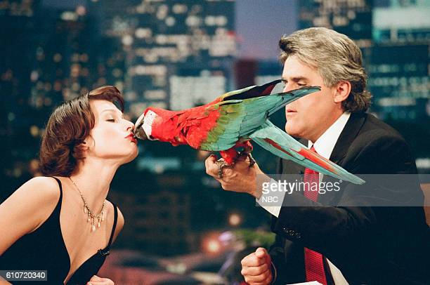 Actress Milla Jovovich kissing a parrot during an interview with host Jay Leno on May 13 1997