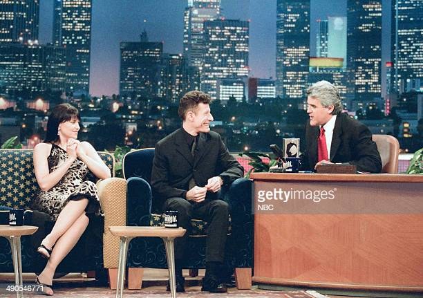 Actress Lucy Lawless and musical guest Lyle Lovett during an interview with host Jay Leno on August 18 1997