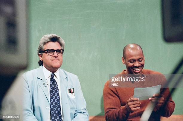Host Jay Leno and music director Kevin Eubanks during the 'Mr Brain' skit on September 17 1997
