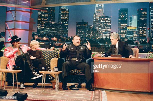 Basketball player Dennis Rodman comedian Ellen DeGeneres and police officer Vinnie Bazain during an interview with host Jay Leno on September 25 1997