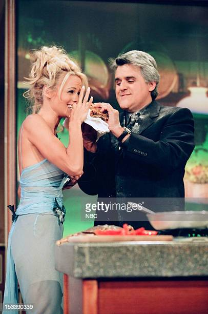 Actress Pamela Anderson and host Jay Leno during a cooking demonstraion on July 17 1998
