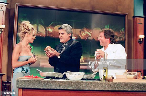 Actress Pamela Anderson host Jay Leno with chef Wolfgang Puck during a cooking demonstraion on July 17 1998