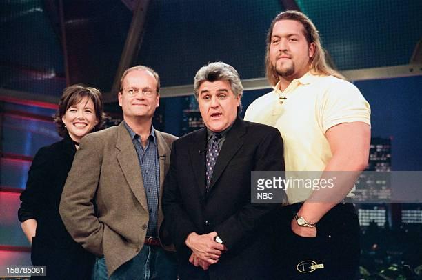 Actress Annette Bening actor Kelsey Grammer host Jay Leno wrestler Paul'Giant' Wight on November 11 1998