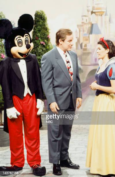 Adam Sandler as Mickey Mouse Phil Hartman as Michael Eisner Nancy Kerrigan during 'Disney' skit on March 12 1994