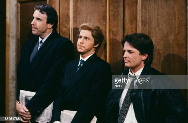 Kevin Nealon as elevator fan Dana Carvey as elevator fan Michael J Fox during the 'Michael's Elevator Fans' skit on March 16 1991