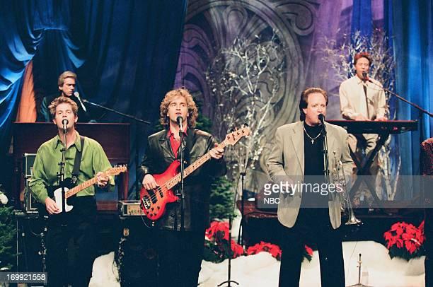 Keith Howland Bill Champlin Jason Scheff Lee Loughnane Robert Lamm of musical guest Chicago perform on December 16 1998