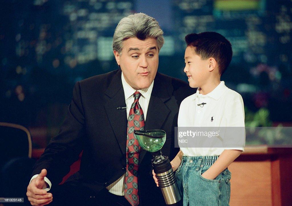 Host Jay Leno, Kurt Waki with a portable potty during the 'Kids Show 'n' Tell' segment on February 16, 1999 --