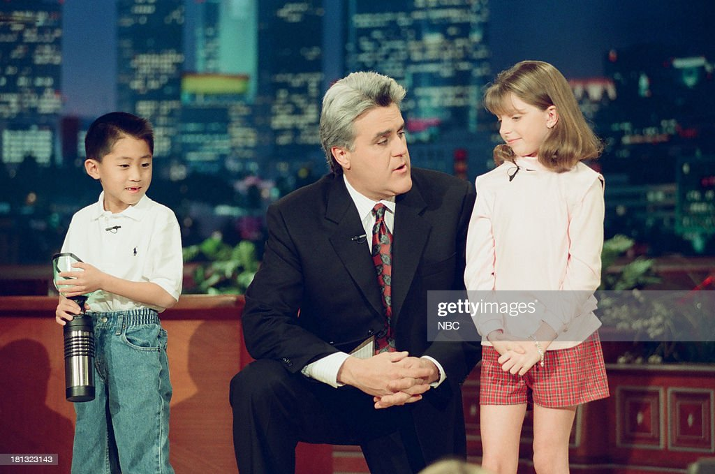 Kurt Waki with a portable potty, host Jay Leno, Jacqueline Willsey with a velcro outfit during the 'Kids Show 'n' Tell' segment on February 16, 1999 --