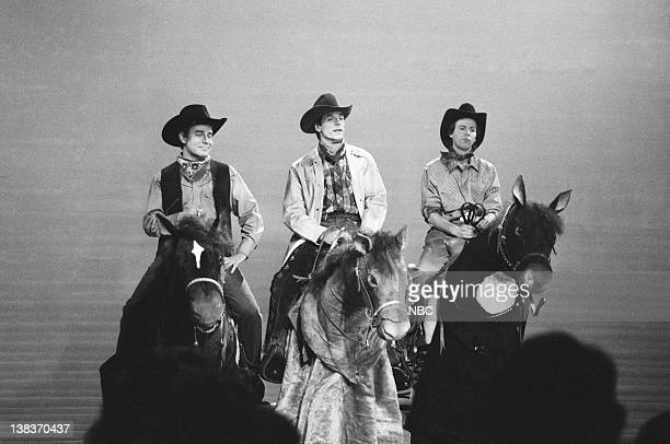 Phil Hartman as cowboy Jeremy Irons as cowboy Dana Carvey as cowboy during the 'When You're A Cowboy' skit on March 23 1991