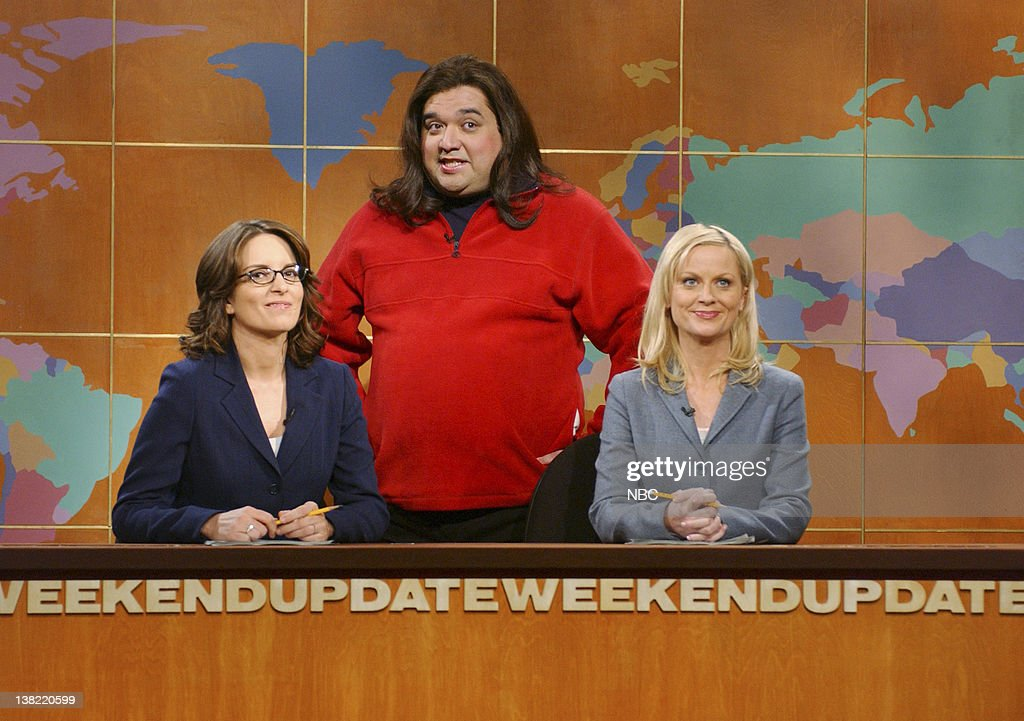 LIVE -- Episode 17 -- Aired -- Pictured: (l-r) Tina Fey, Horatio Sanz as Rosie O'Donnell, Amy Poehler during 'Weekend Update' on May 6, 2006