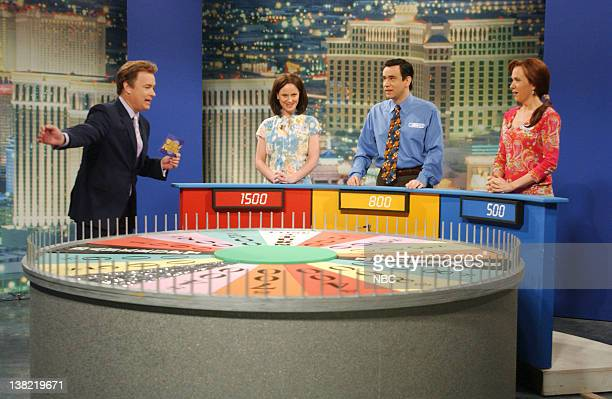 LIVE Episode 17 Aired Pictured Tom Hanks as Pat Sajak Amy Poehler as Donna Fred Armisen as Kenny Kristen Wiig as Marjorie during 'Wheel of Fortune'...