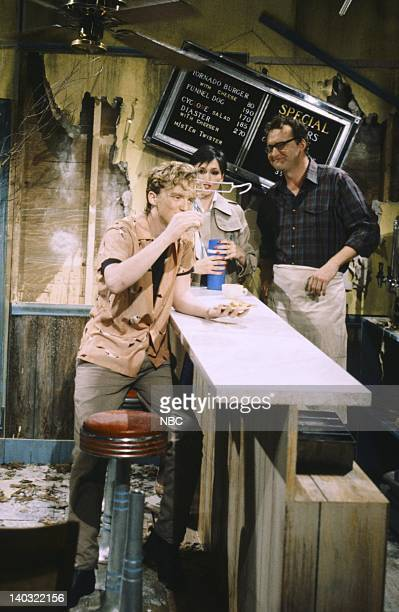 Anthony Michael Hall as Lonnie Nora Dunn as Karen Johnson Randy Quaid as Bud Stubbs during the 'Tornadoville' skit on May 17/1986 Photo by RM Lewis...