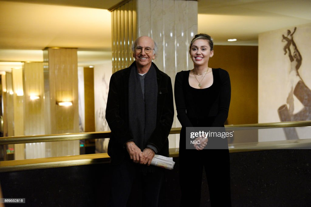 Host Larry David with Musical Guest Miley Cyrus during a promo in 30 Rockefeller Plaza --