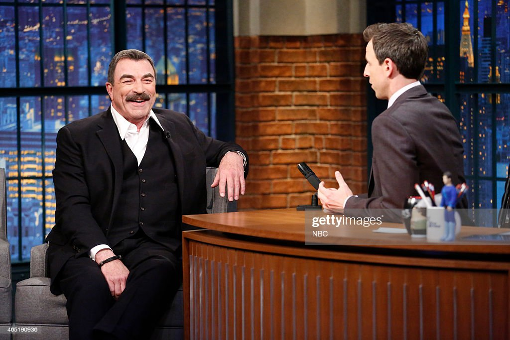 Actor <a gi-track='captionPersonalityLinkClicked' href=/galleries/search?phrase=Tom+Selleck&family=editorial&specificpeople=208627 ng-click='$event.stopPropagation()'>Tom Selleck</a> during an interview with host <a gi-track='captionPersonalityLinkClicked' href=/galleries/search?phrase=Seth+Meyers&family=editorial&specificpeople=618859 ng-click='$event.stopPropagation()'>Seth Meyers</a> on March 3, 2015 --