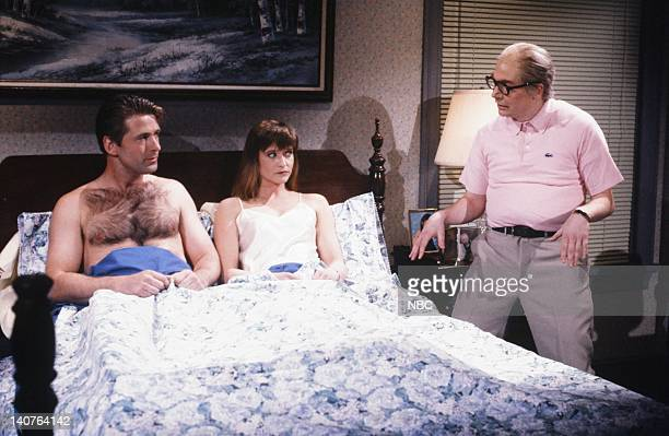 Alec Baldwin as husband Jan Hooks as Wife Mike Myers as middleAged Man during 'MiddleAged Man' skit on April 21 1990 Photo by Alan Singer/NBCU Photo...