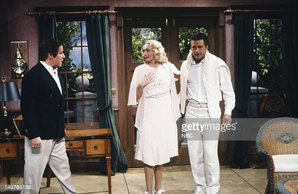 Phil Hartman as Harry Nora Dunn as Wife Alec Baldwin as Mr Cherrywood during 'Greenhilly' skit on April 21 1990 Photo by Alan Singer/NBCU Photo Bank