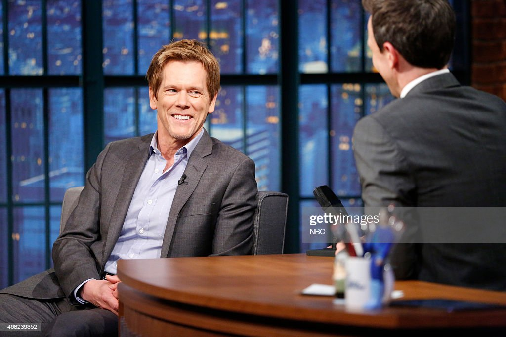 Actor <a gi-track='captionPersonalityLinkClicked' href=/galleries/search?phrase=Kevin+Bacon&family=editorial&specificpeople=202000 ng-click='$event.stopPropagation()'>Kevin Bacon</a> during an interview with host <a gi-track='captionPersonalityLinkClicked' href=/galleries/search?phrase=Seth+Meyers&family=editorial&specificpeople=618859 ng-click='$event.stopPropagation()'>Seth Meyers</a> on March 31, 2015 --