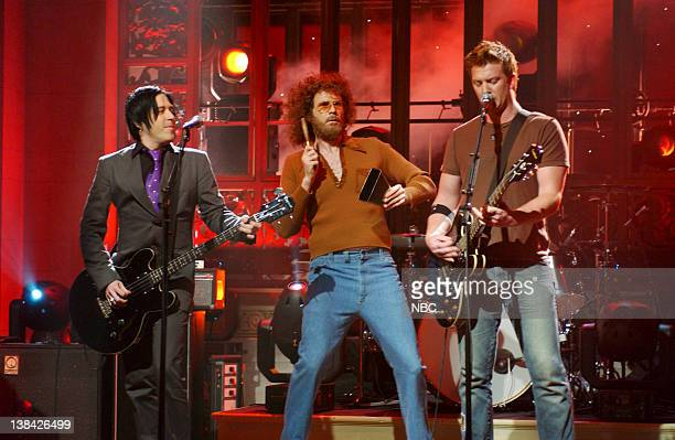 LIVE Episode 19 Aired Pictured Will Ferrell as Gene Frenkle onstage with musical guests Queens of the Stone Age