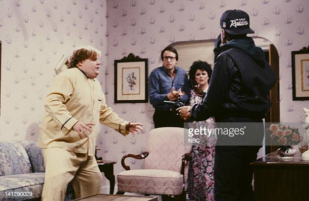 Chris Farley as Eddie Kevin Nealon as Bill Delta Burke as NancyTim Meadows as Willie Horton during 'NRA Theater' skit on July 11 1991 Photo by...