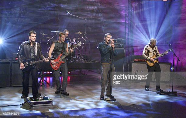 Chris Henderson Todd Harrell Richard Liles Brad Arnold and Matt Roberts of the musical guest 3 Doors Down perform on October 27 2000