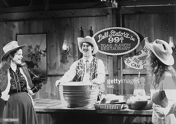 LIVE Episode 21 Air Date Pictured Gilda Radner as cowgirl Dan Aykroyd as Kenny Slungard during the 'Dell Stator's 99 Cent Toad Ranch' skit on May 22...