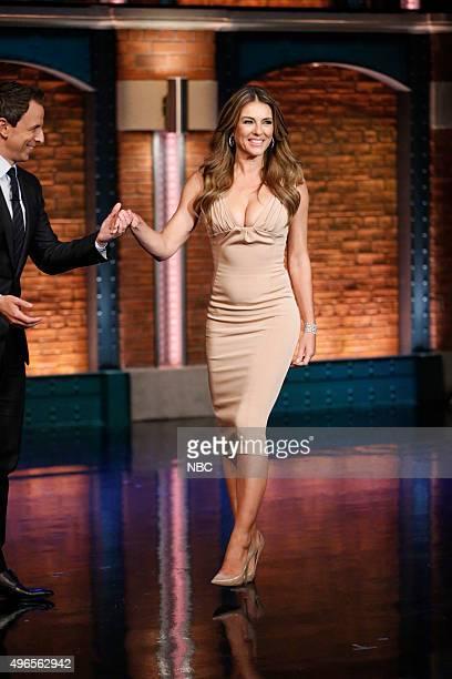 Host Seth Meyers greets actress Elizabeth Hurley on November 10 2015