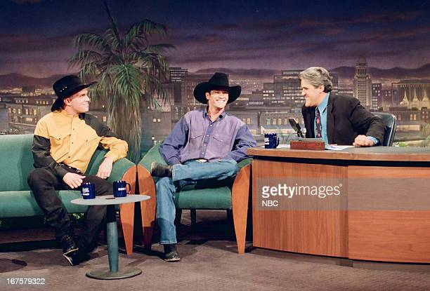 Musical guest Garth Brooks actor Luke Perry during an interview with host Jay Leno on August 30 1993