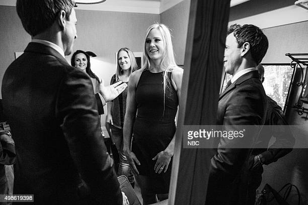 MEYERS Episode 293 Pictured Host Seth Meyers talks with Holly Holm UFC Women's Bantamweight Champion backstage on November 18 2015