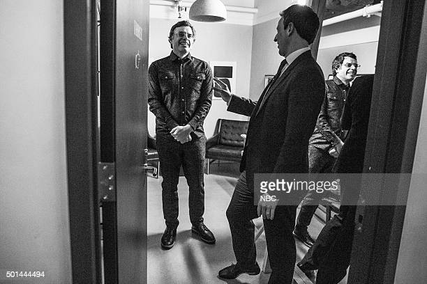 MEYERS Episode 301 Pictured Comedian Jemaine Clement talks with host Seth Meyers backstage on December 14 2015