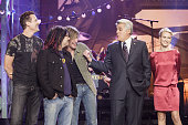 Musicians Mike Malinin Robby Takac and John Rzeznik of musical guest Goo Goo Dolls with host Jay Leno and actress Naomi Watts on December 14 2006