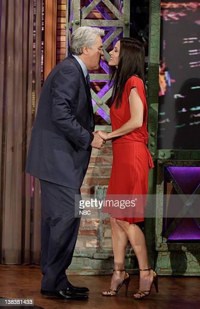 Host Jay Leno greets actress Courteney Cox on February 26 2007